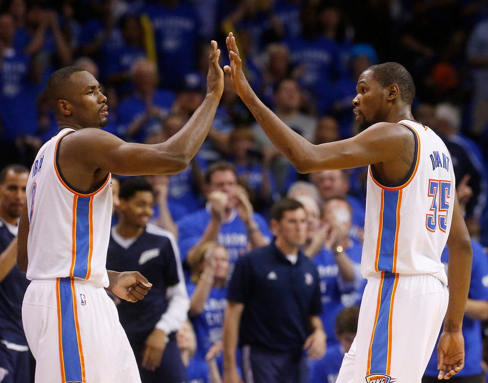 . Oklahoma City Thunder forward Serge Ibaka (9) and forward Kevin Durant (35) exchange high-fives in the fourth quarter of Game 3 of an NBA basketball playoff series in the Western Conference finals against the San Antonio Spurs, Sunday, May 25, 2014, in Oklahoma City. Oklahoma City won 106-97. Durant scored 25 points and 10 rebounds. Ibaka had 15 points. (AP Photo/Sue Ogrocki)