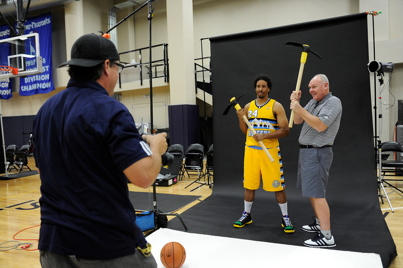 . Denver Nuggets Andre Miller (24) and head coach George Karl poses for team photographer Garrett Ellwood during Media Day at Pepsi Monday, October 1, 2012 at Pepsi Center. The team  unveiled their new alternate uniform. John Leyba, The Denver Post