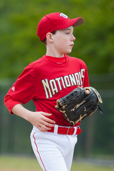 Toby strikes out the batter to end the top of the 5th inning with the Nats leading 9-5. The Nationals almost blew a big lead, but managed to hold off the Rays to win 9-7. They are now 4-2 for the season. 2012 Arlington Little League Baseball, Majors Division. Nationals vs Rays (28 Apr 2012) (Image taken by Patrick R. Kane on 28 Apr 2012 with Canon EOS-1D Mark III at ISO 400, f2.8, 1/2000 sec and 185mm)