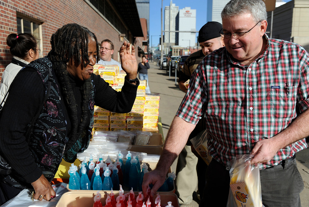 . The Emily Griffith Foundation along with extra assistance from Essie Garrett, left, collected donations from employees of the Emily Griffith Opportunity School to buy nearly 300 lunches for those less fortunate and the folks from nearby homeless shelters. Mike Korn, right, an instructor of clock repair, brings some of his students in need of a good meal, through the lunch line. Kathryn Scott Osler, The Denver Post