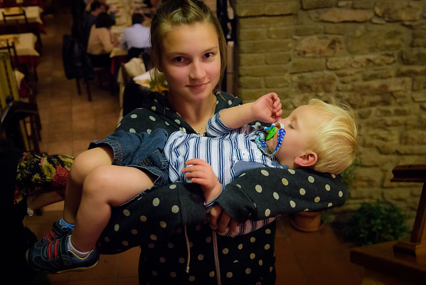 Gabbie carrying a very tired Tomassino out of the restaurant