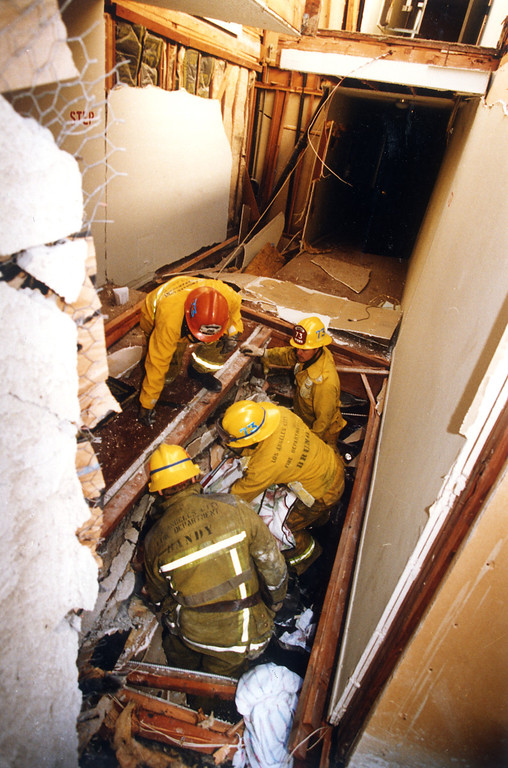 . Firefighters enter the collapsed Northridge Meadows apartments on January 17, 1994.   John McCoy/L.A. Daily News)