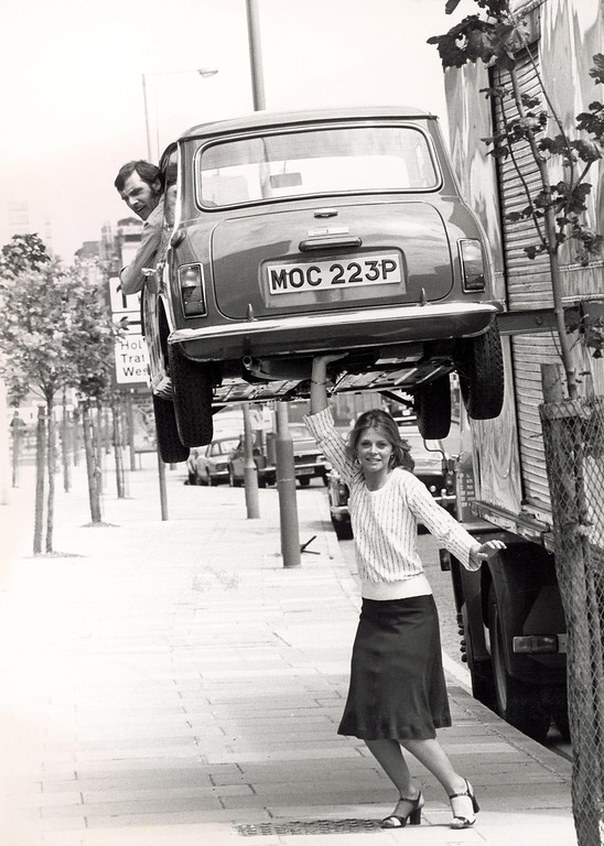 . American actress Lindsay Wagner appears to hold a man in a Mini above her head during a visit to Britain to promote the television series \'The Bionic Woman,\' London, England, June 7, 1976. The car was actually hoisted by a care, which was out of sight of the camera. Wagner is teaching Acting and Directing for Television and Film and Motion Picture Production as an adjunct faculty member at San Bernardino Valley College. (Photo by Express Newspapers/Getty Images)