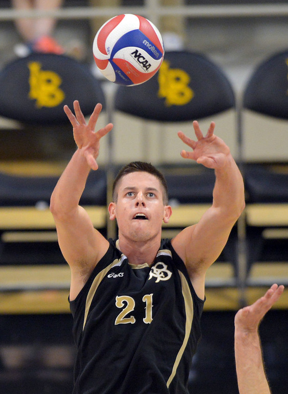 . LBSU\'s Connor Olbright sets up a play in Long Beach, CA on Friday, March 7, 2014 #2 BYU vs #3 Long Beach State men\'s volleyball at Walter Pyramid. (Photo by Scott Varley, Daily Breeze)