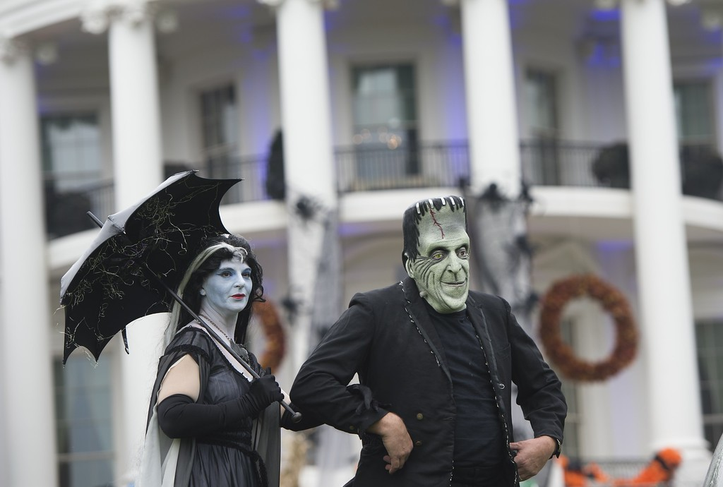 . Frankenstein and Mrs. Frankenstein stand on the South Lawn prior to US President Barack Obama and First Lady Michelle Obama welcoming local children and children of military families to trick-or-treat for Halloween at the White House in Washington, DC, October 31, 2013. AFP PHOTO / Saul  LOEB/AFP/Getty Images
