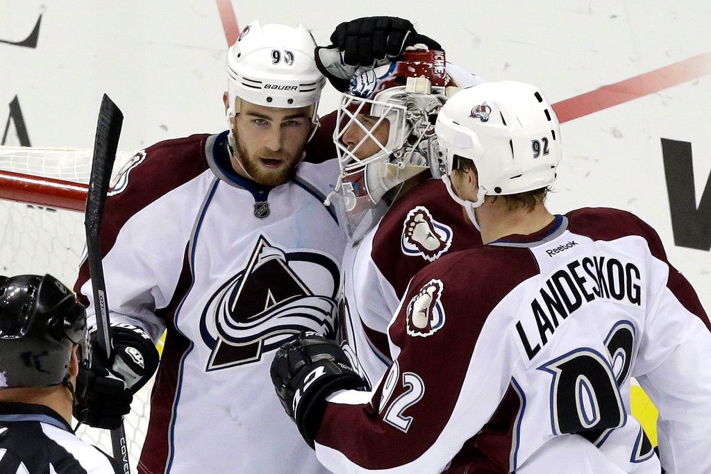. Colorado Avalanche goalie Jean-Sebastien Giguere, center, celebrates with teammates Ryan O\'Reilly (90) and Gabriel Landeskog (92), who scored the game\'s only goal in a 1-0 shutout win over the Pittsburgh Penguins in an NHL hockey game in Pittsburgh Monday, Oct. 21, 2013.  (AP Photo/Gene J. Puskar)