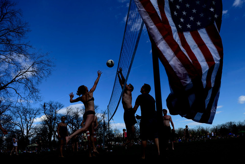 . Josephine Noble hits the ball over Ty Hagaman during a volleyball match at Washington Park. Temperatures reached the low 80s in Denver. (Photo by AAron Ontiveroz/The Denver Post)