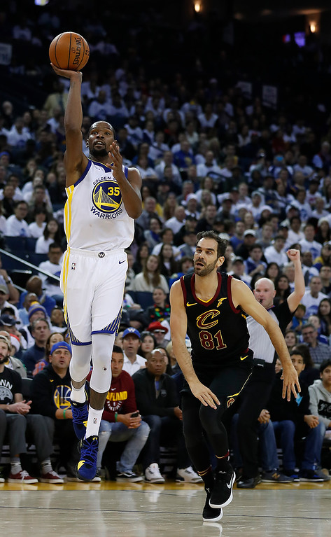 . Golden State Warriors forward Kevin Durant (35) shoots over Cleveland Cavaliers guard Jose Calderon (81) during the second half of an NBA basketball game in Oakland, Calif., Monday, Dec. 25, 2017. The Warriors won 99-92. (AP Photo/Tony Avelar)