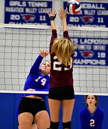 10/11/2019 Mike Orazzi | StaffrSt. Paul's Megan Fortier (14) and Torrington's Sydney Bermas (23) during Thursday night's girls volleyball match in Bristol.