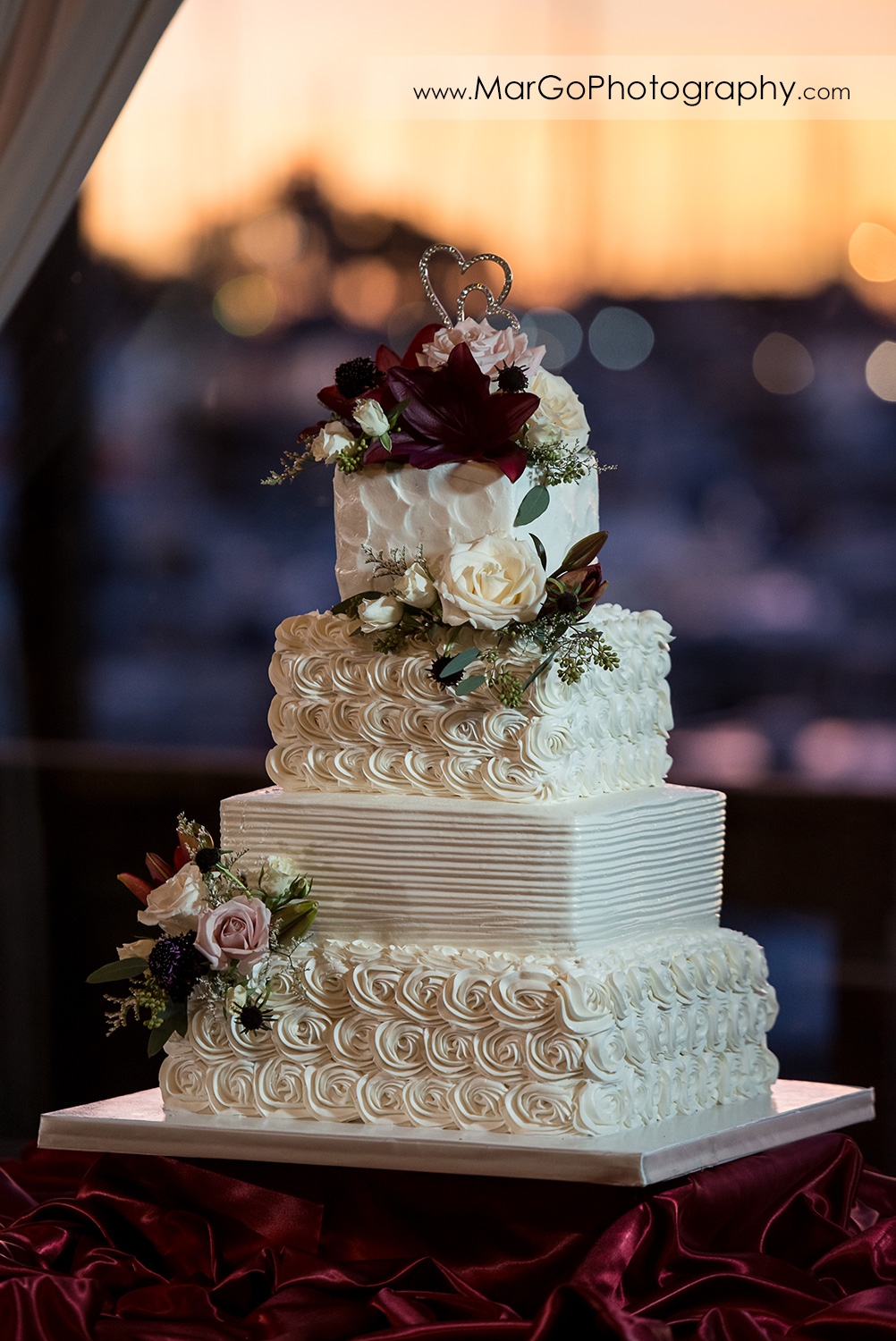 wedding cake decorated with roses at San Diego Mission Bay Park