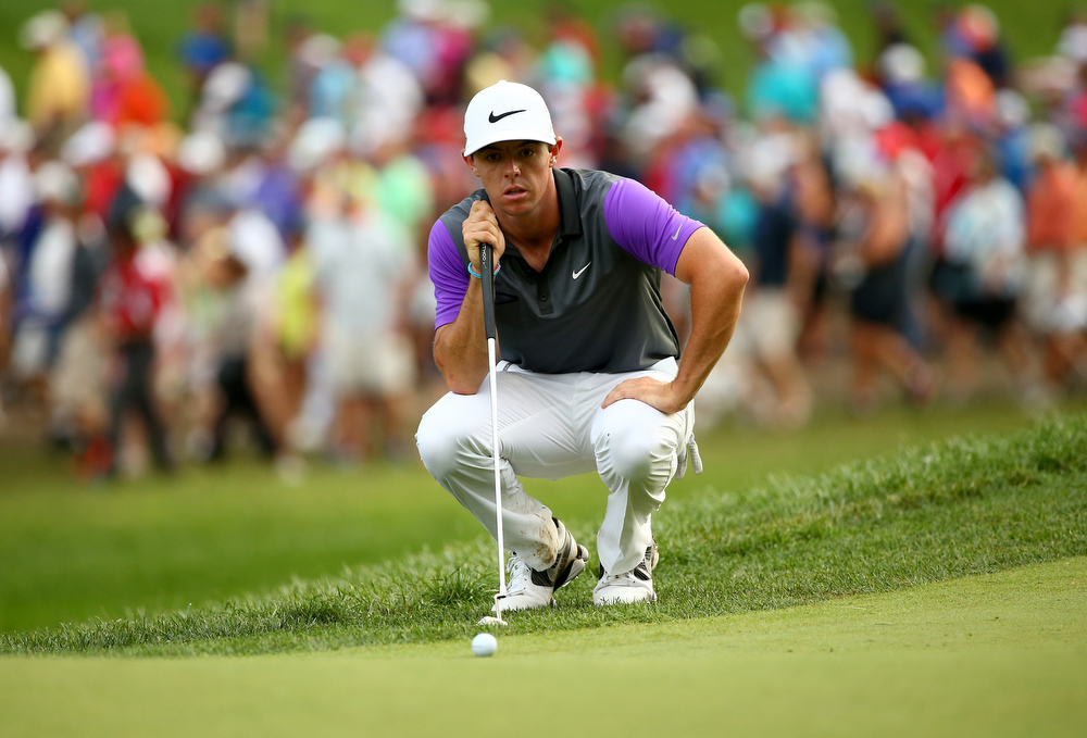 . Rory McIlroy of Northern Ireland lines up a putt on the 14th green during the final round of the 96th PGA Championship at Valhalla Golf Club on August 10, 2014 in Louisville, Kentucky.  (Photo by Andy Lyons/Getty Images)