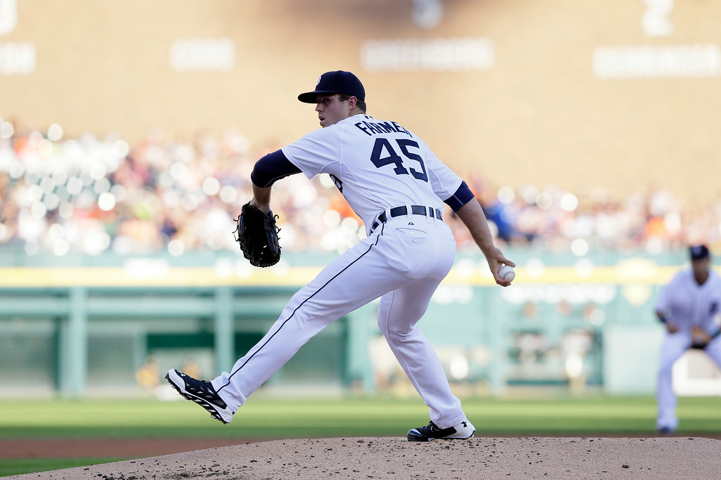 . Detroit Tigers starting pitcher Buck Farmer throws during the second inning of an interleague baseball game against the Pittsburgh Pirates, Wednesday, Aug. 13, 2014 in Detroit. (AP Photo/Carlos Osorio)