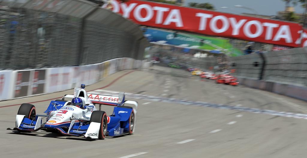 . Helio Castroneves streaks down Shoreline Drive Sunday. Scott Dixon (9) wins the Toyota Grand Prix of Long Beach Sunday April 19, 2015.  (Will Lester/Staff Photographer)