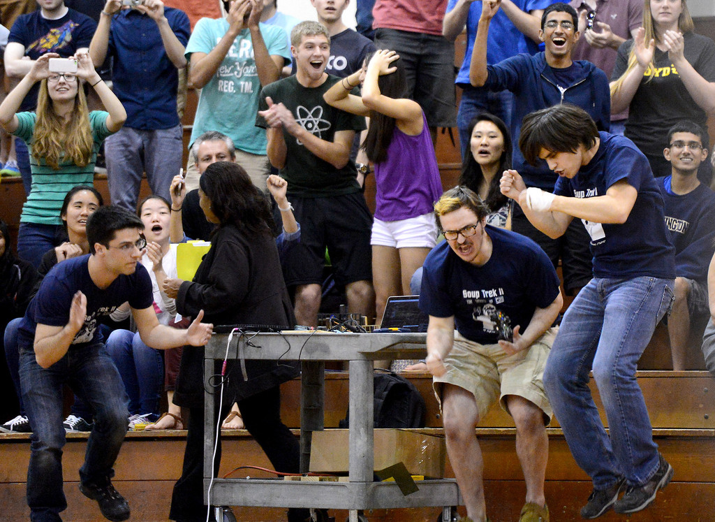 """. The Cunning Stunts celebrate continuing on during the final round as mechanical engineering Caltech students compete in the annual ME72 Engineering Design Contest at the Pasadena campus Tuesday, March 11, 2014. The goal in \""""Raiders of the Lost Can\"""" was to move their team\'s can closest to the center of a platform. (Photo by Sarah Reingewirtz/Pasadena Star-News)"""