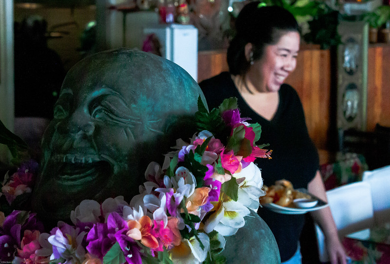 Photo Story. Nui Wright, a courageous woman from Chiang Mai, Thailand. She and her three sisters came over to the United States at a young age and have spent their whole lives working to get to where they are now. Nui and her husband Arthur (not pictured) run a Thai restaurant in downtown Kona, Hawaii. Every time any customer walks into the establishment there is a smile on Nui's face, she serves the food of her homeland and wants to carry on traditional Thai cuisine for generations to come. Her heart for hospitality and serving others is very evident and once she sees you twice she will not forget what you favorite thing is to eat every time you walk in those doors. With that she provides a place of comfort, good conversation and food that warms the soul.