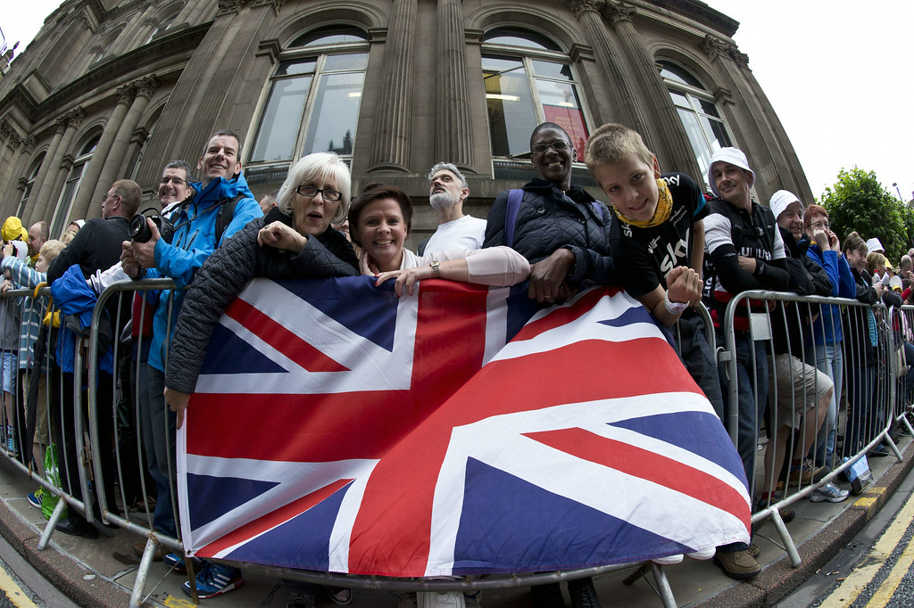 . Britain\'s supporters are pictured at the departure village before the start of the 190.5 km first stage of the 101st edition of the Tour de France cycling race on July 5, 2014 between Leeds and Harrogate, northern England.  The 2014 Tour de France gets underway on July 5 in the streets of Leeds and ends on July 27 down the Champs-Elysees in Paris.  LIONEL BONAVENTURE/AFP/Getty Images