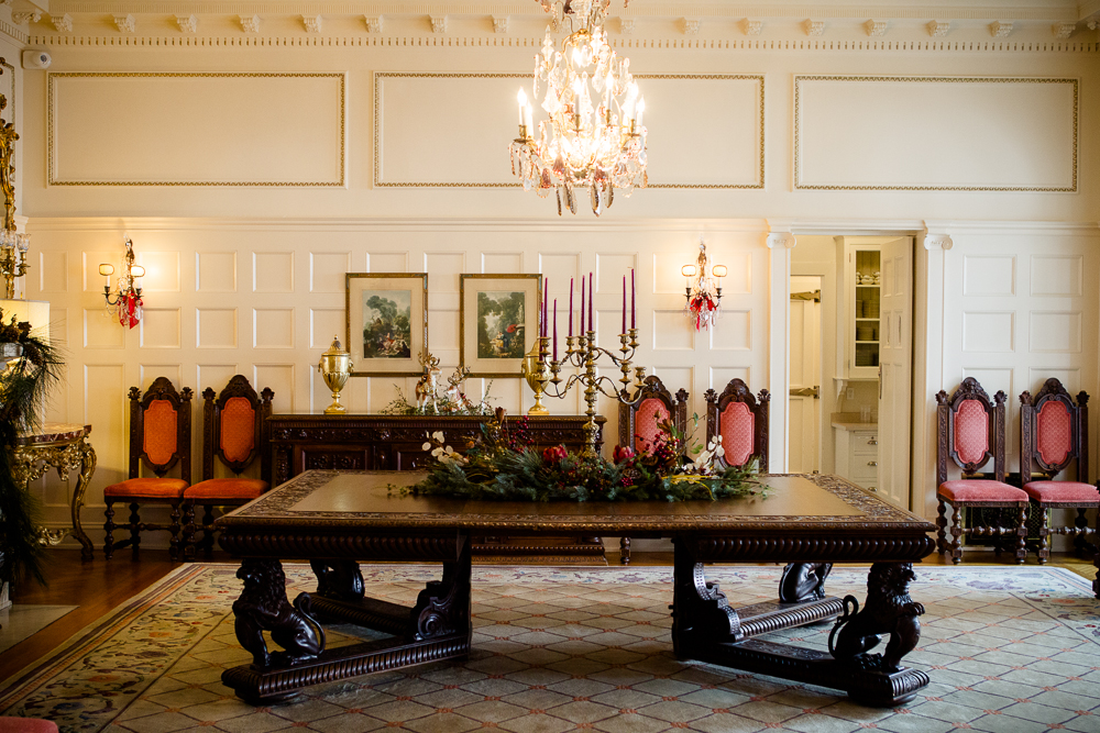 . Bows, garlands and swags -- and in the background, two reindeer figurines -- decorate a room at the Governor\'s Residence at Boettcher Mansion. Photo by Mark Broste