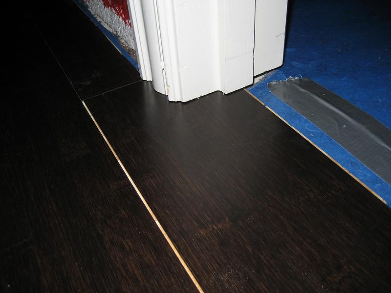 Putting flooring into closet entrance.