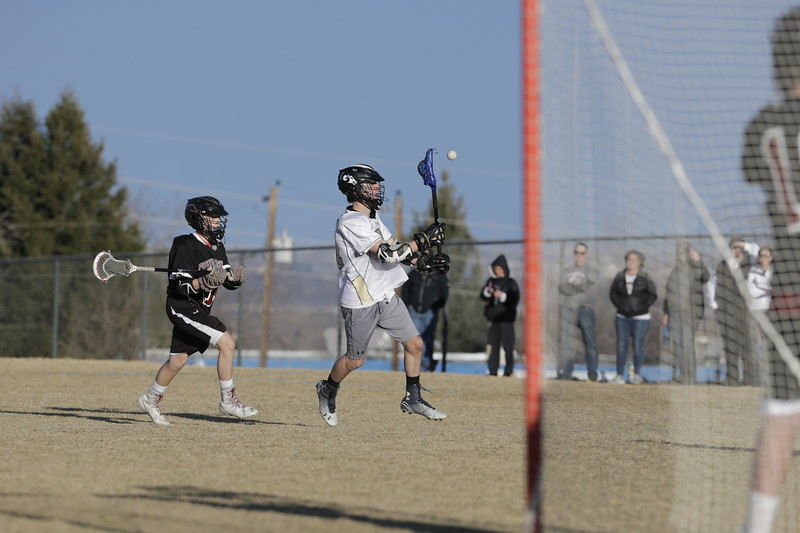 JPM0292-JPM0292-Jonathan first HS lacrosse game March 9th.jpg