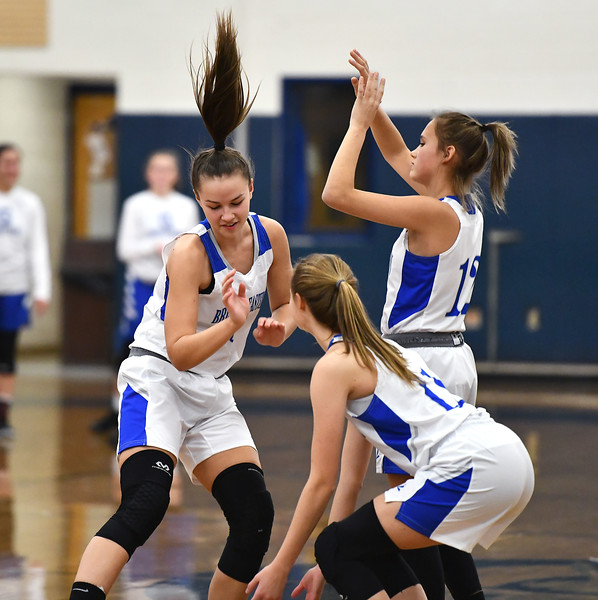 12/19/2019 Mike Orazzi | Staff Bristol Eastern's Sage Scarritt (25), Cali Doyon (12) and Ciara Collins (11) during Thursday night's girls basketball game with Glastonbury.