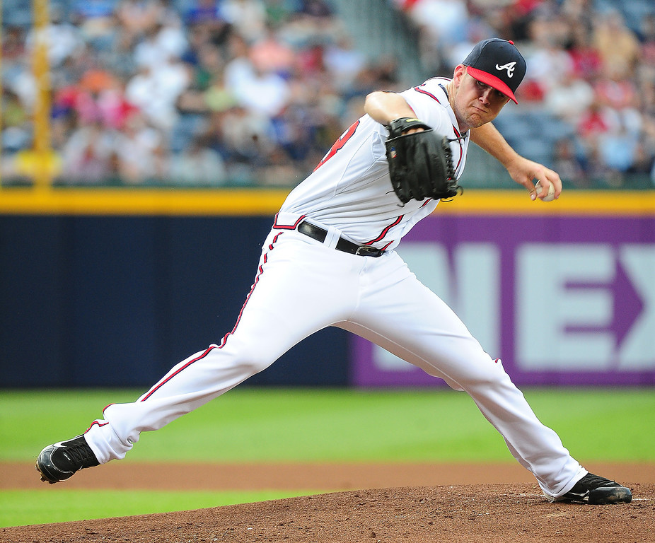 . Alex Wood #58 of the Atlanta Braves pitches against the Colorado Rockies at Turner Field on July 30, 2013 in Atlanta, Georgia. (Photo by Scott Cunningham/Getty Images)