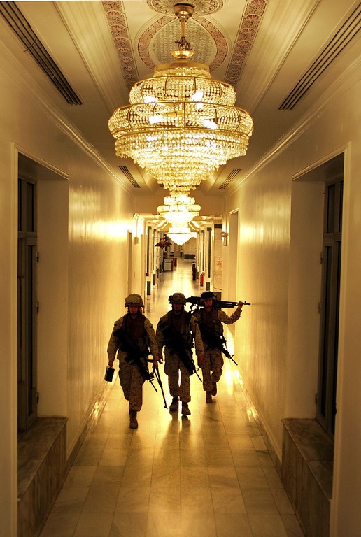 . Members of the U.S. Marine Security Force walk through the halls of the U.S. Embassy February  6, 2007 in Baghdad, Iraq . The platoon of Marines from the Anti-Terrorism Battalion was tasked with defending the exterior of U.S. diplomatic mission against attacks in one of the most dangerous cities in the world. (Photo by John Moore/Getty Images)