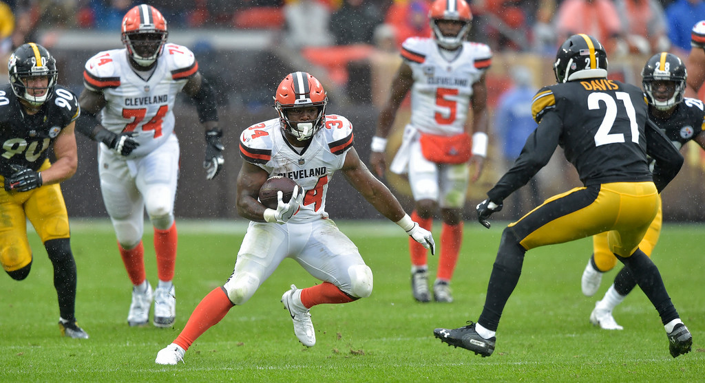 . Cleveland Browns running back Carlos Hyde (34) rushes during the first half of an NFL football game against the Pittsburgh Steelers, Sunday, Sept. 9, 2018, in Cleveland. (AP Photo/David Richard)
