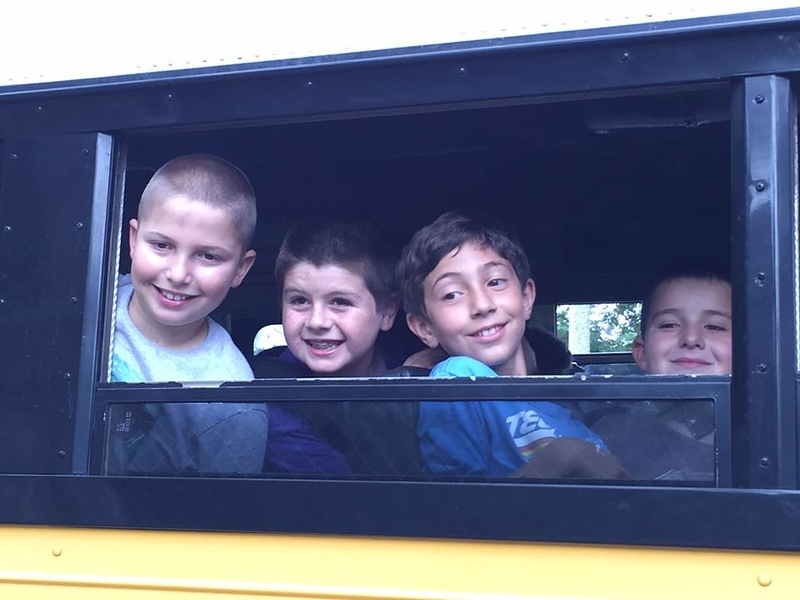 Zachary and friends on bus to Akiba Resident Camp 7-22-15.jpg