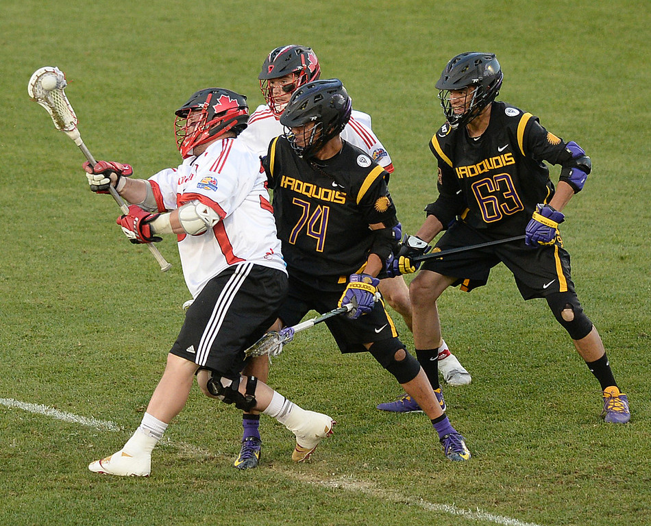 . COMMERCE CITY, CO - JULY 17: Canada midfielder Geoff Snider (35) came up with the ball after a face-off with Iroquois midfielder Jeremy Thompson (74) in the first quarter. The Iroquois Nationals took on Canada in a FIL World Championship semifinal game Thursday night, July 17, 2014.  Photo by Karl Gehring/The Denver Post