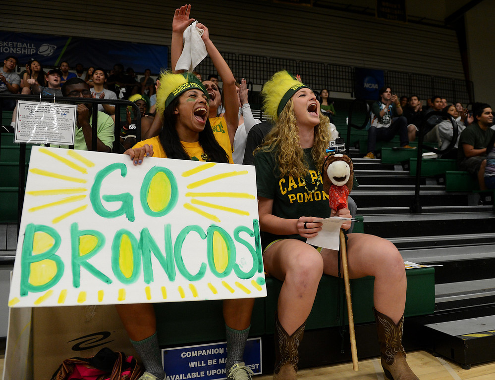 . Cal Poly Pomona students Christen Williams, left, and Alexandra Hasen cheer as Cal Poly Pomona makes a basket against Montana State Billings during the NCAA Division II West Regional championship game at Cal Poly Pomona in Pomona, CA, Monday, March 17, 2014. (Photo by Jennifer Cappuccio Maher/Inland Valley Daily Bulletin)