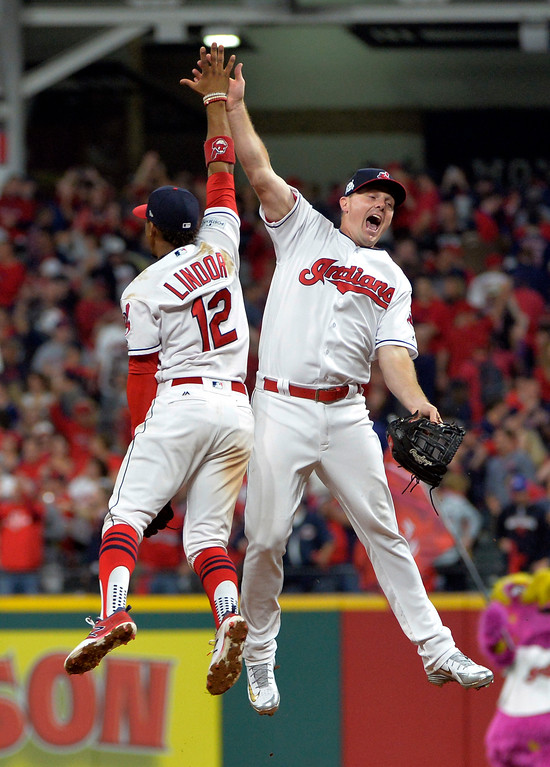 . Cleveland Indians\' Jay Bruce, right, and Francisco Lindor celebrate after the Indians defeated the New York Yankees 4-0 in Game 1 of a baseball American League Division Series, Thursday, Oct. 5, 2017, in Cleveland. (AP Photo/Phil Long)