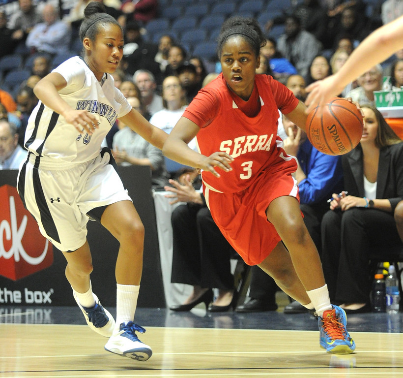 . 02-27-2012--(LANG Staff Photo by Sean Hiller)- Serra vs. Windward in Wednesday\'s girls basketball CIF SS Div. 4AA title game at the Anaheim Convention Center Arena in Anaheim. Serra\'s Siera Thompson (3) drives against Windward\'s Courtney Jaco (10).