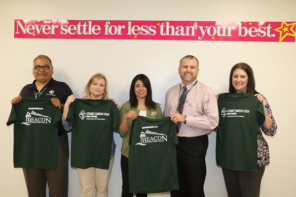 Beacon Credit Union donate students shirt