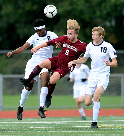 10/17/2018 Mike Orazzi | Staff Bristol Central's Ellis Carmelich (6) and Newington's Louis Egbuna (2) and Erik Kozikowski (18) during boys soccer at BC Wednesday afternoon.