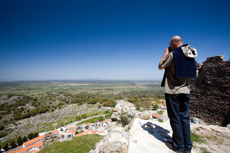 Visitor taking pictures from Montanchez castle, Extremadura, Spain