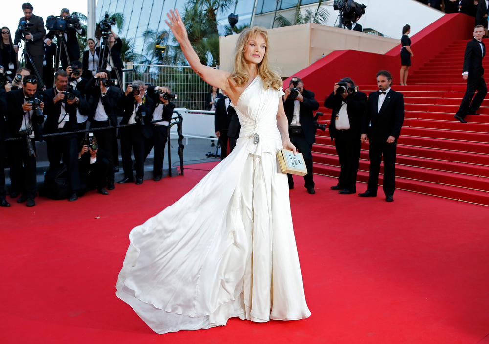 ". Actress Arielle Dombasle poses on the red carpet as she arrives for the screening of the film ""Nebraska\"" in competition during the 66th Cannes Film Festival in Cannes May 23, 2013.        REUTERS/Eric Gaillard"