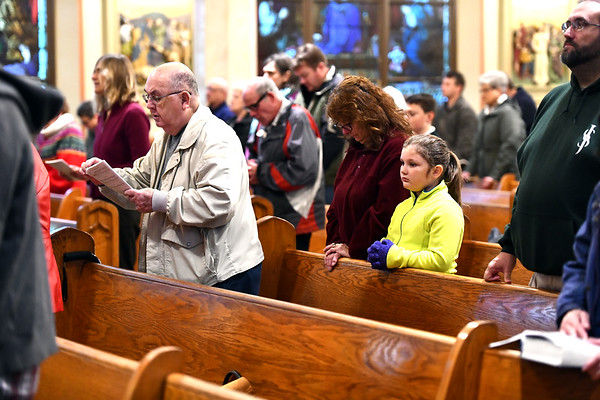 11/9/2019 Mike Orazzi | StaffrFr. Ivan Ramirez oversees a mass for Veterans at St. Joseph Parish on Federal Hill in Bristol on Saturday.