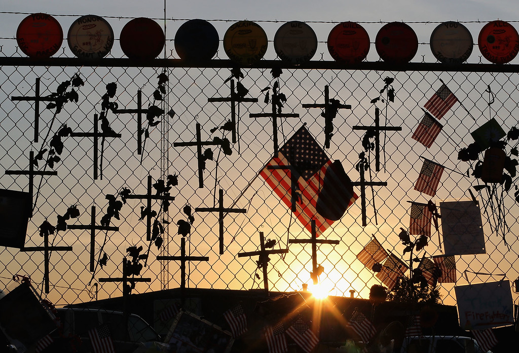 . Nineteen crosses and American flags adorn the fence outside of Station 7 on July 3, 2013 in Prescott, Arizona. Nineteen firefighters based out of Station 7 died battling a fast-moving wildfire near Yarnell, Arizona on June 30. Station 7 has been the home of the Granite Mountain Interagency Hotshot Crew since 2010.  (Photo by Christian Petersen/Getty Images)
