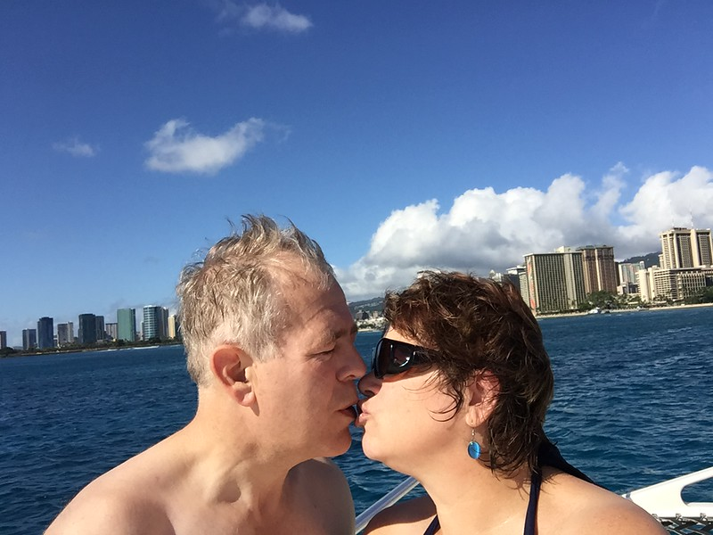 Trying to kiss awkwardly on a moving catamaran