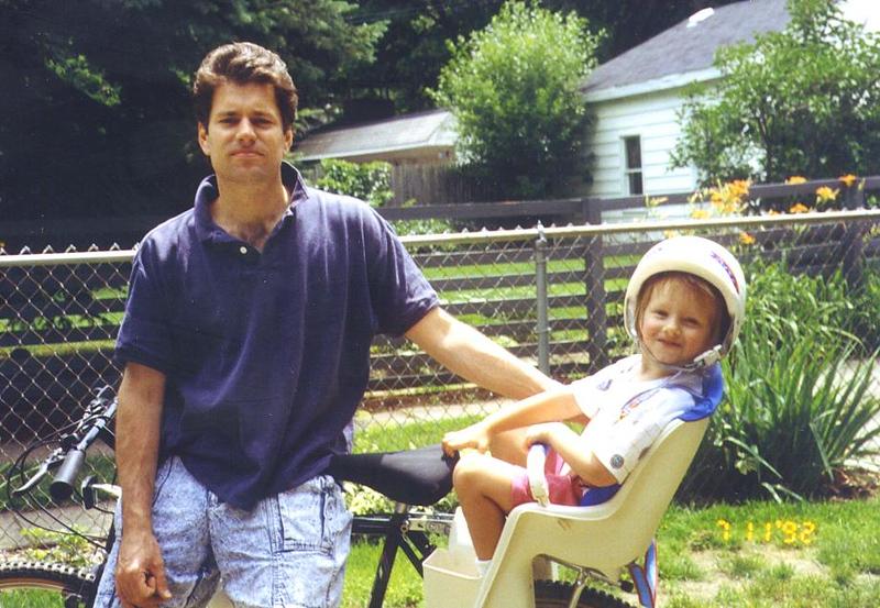 ted and tatum on back of bike.jpg