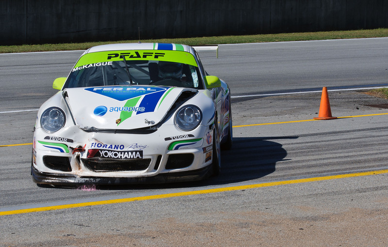 Shaun McKaigue's Porsche GT3 Cup car with fresh wounds received during a first-lap incident along the front straight.
