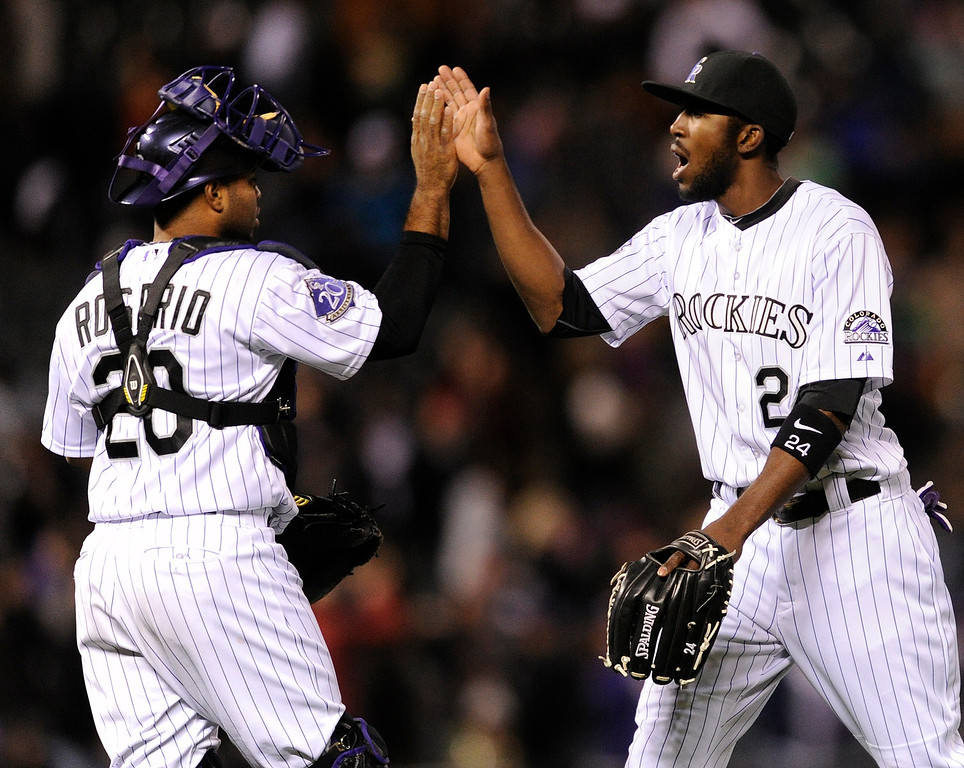 . DENVER, CO. - APRIL 19:  Wilin Rosario and Dexter Fowler celebrated the win Friday night. The Colorado Rockies defeated the Arizona Diamondbacks 3-1 at Coors Field Friday night, April 19, 2013.  Photo By Karl Gehring/The Denver Post)