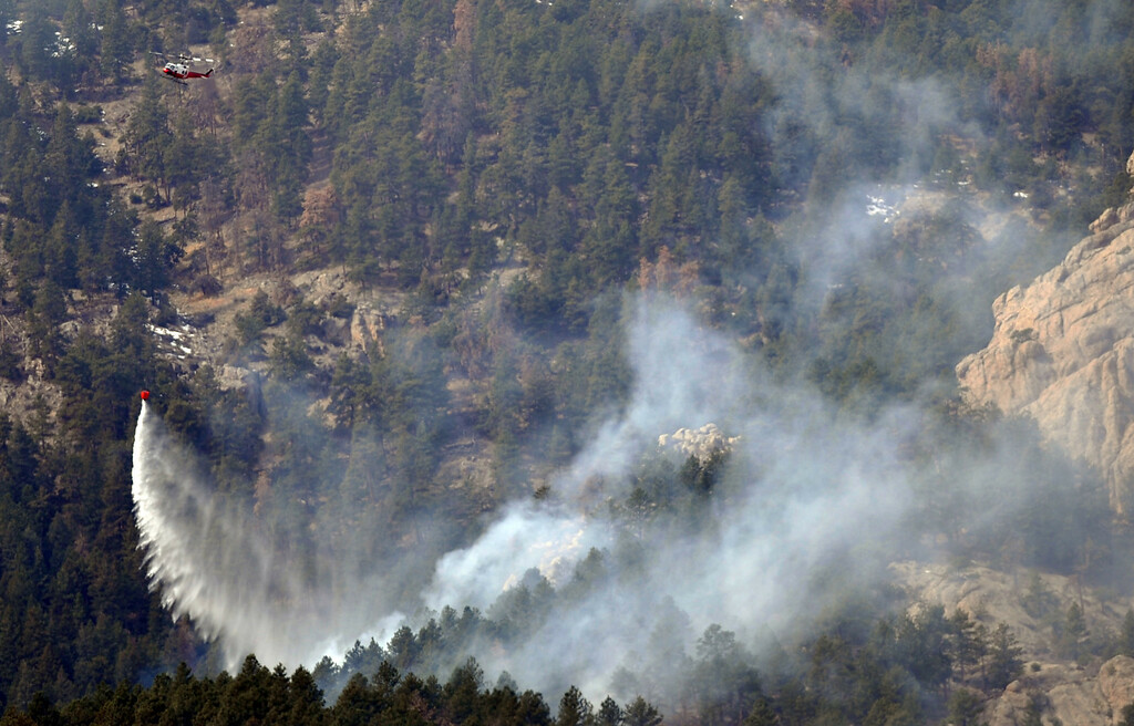 . FORT COLLINS, CO. - MARCH 16: A helicopter dumps water at the Galena wildfire in Larimer County. The wildfire pushed west overnight through Lory State Park, driven by wind gusts reaching 45 mph. Fort Collins, Colorado. March 16, 2013. (Photo By Hyoung Chang/The Denver Post)