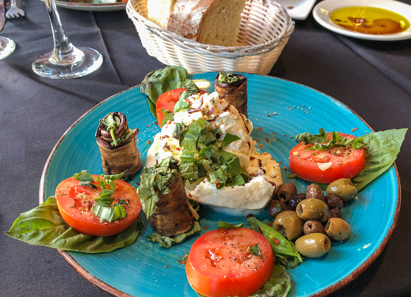 Colorful antipasti on a blue plate served during a girlfriends getaway.