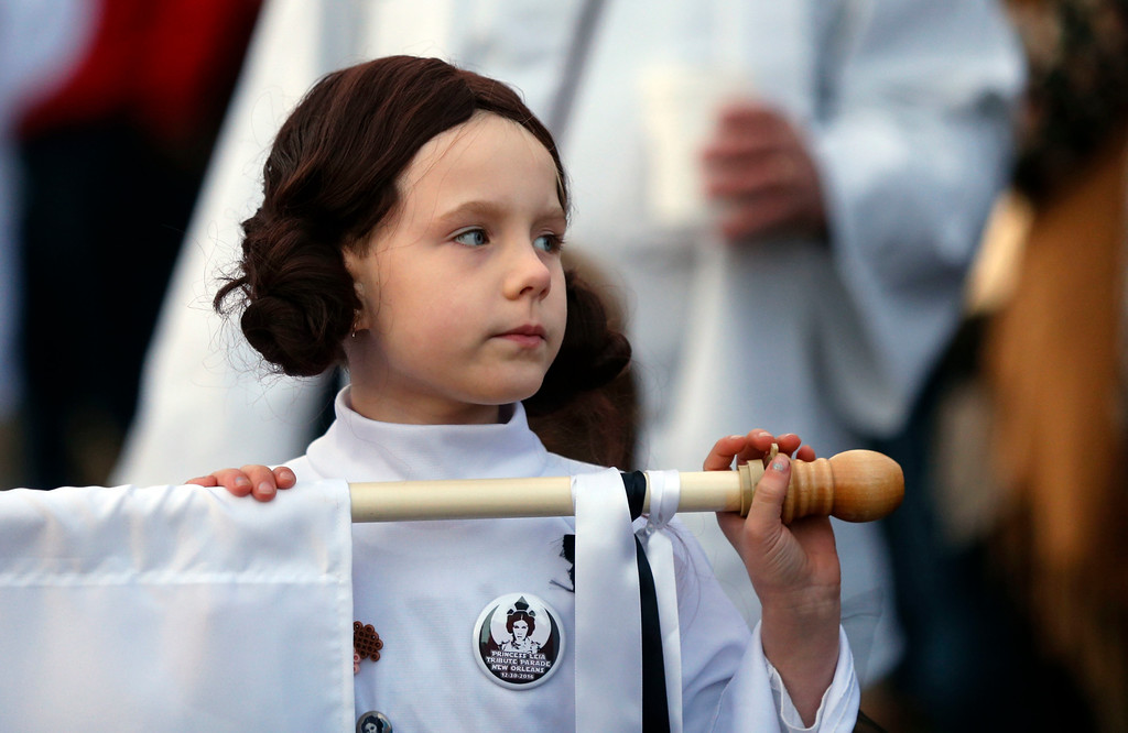 ". Addy Longlois, 7, dressed as Princess Leia, walks in a parade in honor of actress Carrie Fisher, who played Princess Leia in the ""Star Wars\"" movie series, in New Orleans, Friday, Dec. 30, 2016. Fisher died on Dec. 27, 2016, at the age of 60. The parade was held by the Krewe of Chewbacchus, a \""Star Wars\"" themed Mardi Gras Krewe. (AP Photo/Gerald Herbert)"