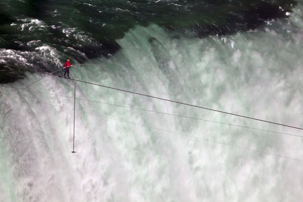 . Nik Wallenda walks over Niagara Falls on a tightrope in Niagara Falls, Ontario, on Friday, June 15, 2012. Wallenda has finished his attempt to become the first person to walk on a tightrope 1,800 feet across the mist-fogged brink of roaring Niagara Falls. The seventh-generation member of the famed Flying Wallendas had long dreamed of pulling off the stunt, never before attempted. (AP Photo/The Canadian Press, Frank Gunn)