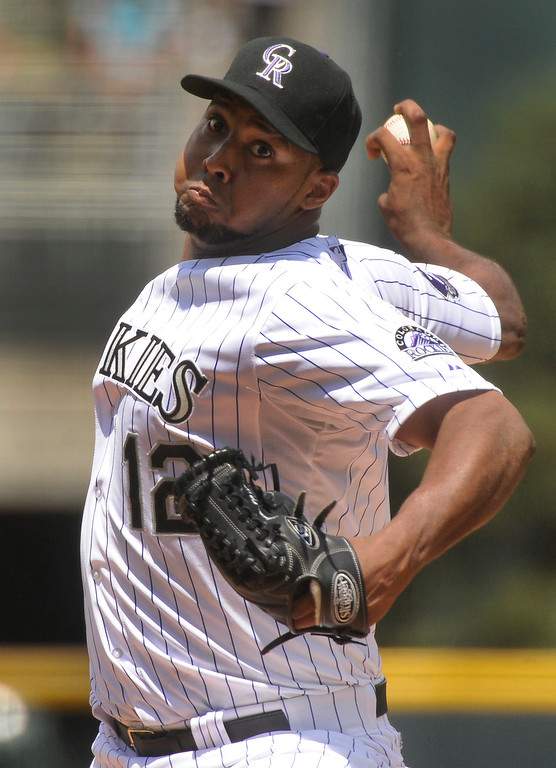 . Rockies starter Juan Nacasio delivered to the plate in the first inning. The Colorado Rockies hosted the Miami Marlins at Coors Field Thursday afternoon, July 25, 2013. Photo By Karl Gehring/The Denver Post