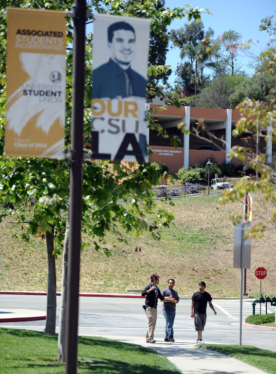. Students and faculty leave the campus after a bomb threat closed the campus of Cal State Los Angeles on Thursday, April 18, 2012 in Los Angeles, Calif.    (Keith Birmingham/Pasadena Star-News)