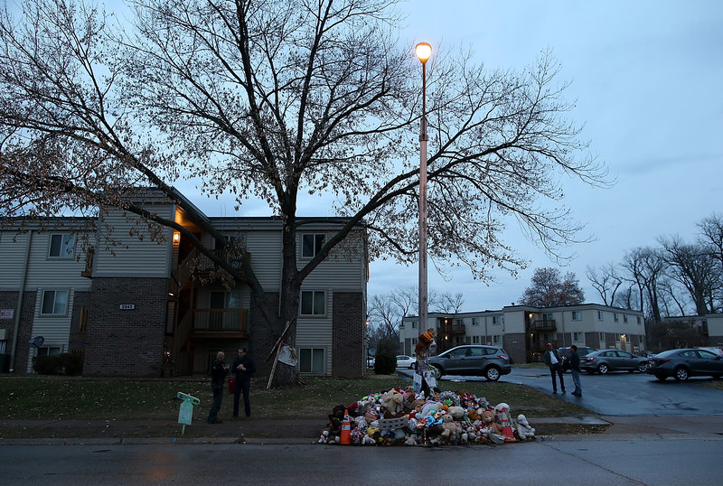 . A pile of stuffed toys sits at the base of a lamp post near where 18-year-old Michael Brown was shot and killed on November 22, 2014 in Ferguson, Missouri. Tensions in Ferguson remain high as a grand jury is expected to decide this month if Ferguson police officer Darren Wilson should be charged in the shooting death of Michael Brown.  (Photo by Justin Sullivan/Getty Images)