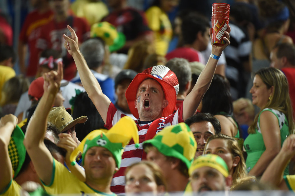 Description of . An US fan cheers during a Group G football match between Ghana and US at the Dunas Arena in Natal during the 2014 FIFA World Cup on June 16, 2014.  AFP PHOTO / EMMANUEL DUNANDEMMANUEL DUNAND/AFP/Getty Images